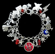 This stunning Tibetan silver charm bracelet is inspired by the books and movie from the series Vampire Academy. DESCRIPTION Packed with