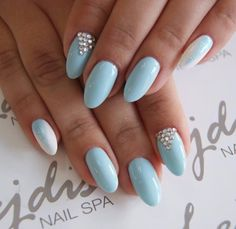 What about this pale blue gel nails with a triangle of gems on it?? If you like these nails follow @spnnails on instagram.