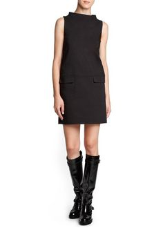 Layer with blouse or thin knit sweater underneath, tights and boots.  Mango shift dress.