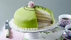 This Swedish layer cake is great fun - bright green and full of custard, jam, marzipan, and a mound of whipped cream!     Equipment and preparation: for this recipe you will need a piping bag with a 1cm/½in plain nozzle, a medium star nozzle, a 23cm/9in springform tin and a sugar thermometer.
