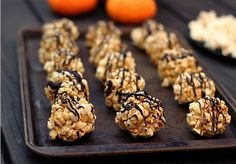 Pin for Later: 17 Treats to Celebrate Halloween the Healthy Way Dark-Chocolate-Drizzled Popcorn Balls