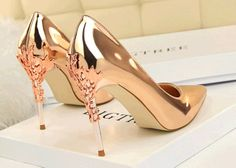 Product Sexy luxury candy color pumps with metallic heels, sharp head, pull on type, high slim heels, patent leather, anti-skidding sole Heel 10 cm Platform 0.5 cm Size Option SA Size 2-6, Euro Size 34-39, US Size 4-8.5 Color option, blac...