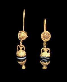 A PAIR OF GREEK GOLD AND AGATE EARRINGS   HELLENISTIC PERIOD, CIRCA 2ND-1ST CENTURY B.C.  Each with a high arching earwire joined to the back of a circular box, the front ornamented with a domed rosette framed by beaded and plain wires, the petals rimmed with beaded wire, an amphora pendant suspended below composed of a banded agate bead capped with gold hemispheres of petals rimmed with beaded wire, on a cylindrical stem joined to a square foot, the wire handles with leaf-shaped terminals