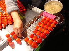 Tanghulu-- (also called bingtanghulu, is a traditional Chinese snack of candied fruit. It originated from northern China, but it is now commonly available in most Chinese cities, such as Beijing, Tianjin, Shanghai.