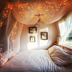 I LOVE this idea for above my bed...and with white or cream colored curtains...Anne, you could totally go with black curtains and fairy lights...just sayin!