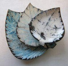 Maarit-Mattanen-Raku-leaves-  I especially like the bottom one with more blue glaze....it feels more like winter.