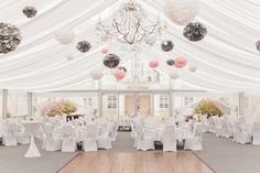 Glamorous Wedding Tent with pom-poms and a chandelier // Pink and Gray Whimsical Wedding