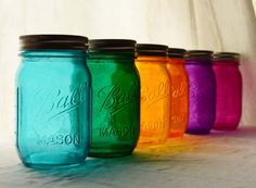 Stained glass mason jar wedding decor, I could even put our tealight candles in them :)