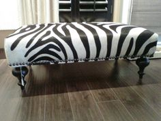 Hair on Hide Custom Zebra Ottoman with Steel Grey Studs and Black Wooden Legs by Sheila's Window Toppers