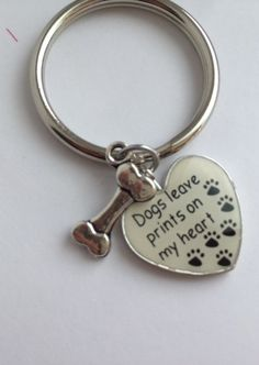 Prints on my heart keychain.  For any dog lover or pet care professional in your life. Paw Prints, dog lover, animal lover.  Pet passing by Lexiandfriends on Etsy