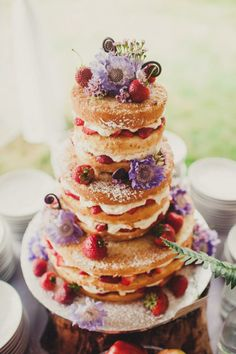 A naked cake, by Raindrop Desserts, shows off fresh strawberries and cream inside.