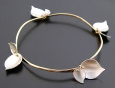 "Bracelet | Aileen Lampman. ""Bamboo"". Sterling silver with gold filled branches.  Also available in just sterling silver."