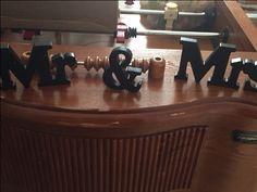 "Wooden Black ""Mr. & Mrs."" signs"