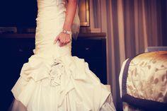 Love the detail on this dress. Photo by Eileen. #minneapolisweddingphotographers #weddingdress