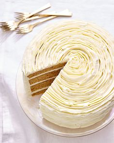 Carrot Cake with White-Chocolate Frosting | Martha Stewart - Ruffles of white chocolate-cream cheese frosting take this carrot cake to the next level. Seen from above, it looks like a rose. Make this cake a day or two ahead for the best flavor. #carrotcake #cakerecipe #chocolatefrosting Layer Cake Recipes, Frosting Recipes, Buttercream Frosting, Dessert Recipes, Layer Cakes, Cupcake Recipes, Chocolate Cream Cheese Frosting, Chocolate Buttercream, Chocolate Cupcakes