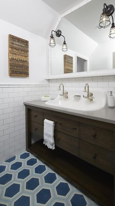 brown washstand with trough sink and blue hex floor bathroom