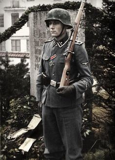 SS-Scharfuhrer on guard at the SS Schule-Tolz