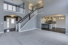 Mayfair Family Room & Entry- Eastbrook Homes, MI #NewHome #RealEstate #FamilyHome #Entryway #EastbrookHomes