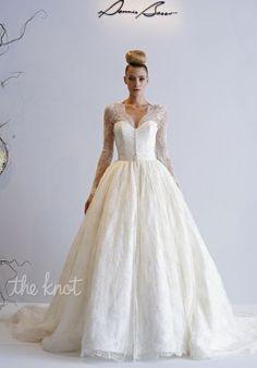 Gown features belt at waistline.