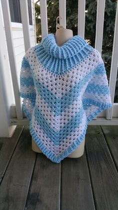 Hot Off My Hook! Project: Cowl Neck Poncho Started: 08 Feb 2016 Completed: 10 Feb 2016 Model: Madge the Mannequin Crochet Hook(s): 7mm, Cowl portion, K, Granny Stitch portion Yarn: Red Heart Super Saver, Bernat Super Value Color(s): Light Blue, White Pattern Source: Simply Crochet Magazine, Issue No. 25 (Hard Copy) Pattern Designed By: Simone Francis Notes: This is my 75th Cowl-Neck Poncho and I remade it for very special lady!