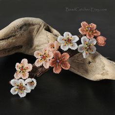 Cherry blossom hair barrette by BeadCatcher on Etsy, $70.00.   There is a tutorial in her shop on Etsy for the flower.  Click site and look around.