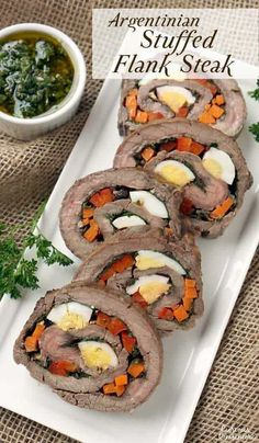 Matambre Arrollado is a flavorful Argentinian Stuffed Flank Steak that makes a unique and beautiful main dish or appetizer. | www.CuriousCuisiniere.com