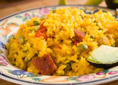 Arroz con Gandules-Any special occasion meal in Puerto Rico would not be complete without Arroz con Gandules. Afterall, Rice with Pigeon Peas is Puerto Rico's national dish. This recipe is a rice and pea dish seasoned with sofrito and diced ham. Puerto Rican Sofrito, Puerto Rican Cuisine, Puerto Rican Recipes, Comida Latina, Arroz Con Gandules, Comida Boricua, Spanish Dishes, Spanish Food, Spanish Rice