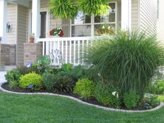 love the grass at the corner & textures of the other plants - fresh look for foundation plantings