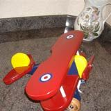 Toy biplane for their first grandson. Go to http://www.woodworkingdownunder.com/wooden_toy_airplane.html for free plans.