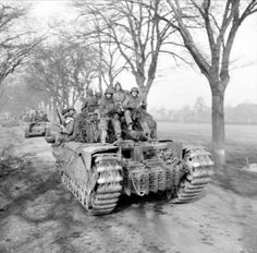 Churchill tanks of 6th Guards Tank Brigade carrying paratroopers of the 17th US Airborne Division, Germany, 29 March 1945.