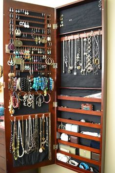misanthropy creations: 36 Jewelry Storage Ideas: Revisited!--Notice the fabric pouch at the bottom of the door for those necklaces that are long and might hang down below the door--good idea!