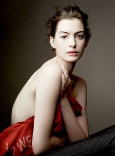 This photograph is fantastic. Such beautiful lighting and an elegant pose.   Anne Hathaway by Annie Leibovitz