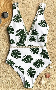 Have some fun in the sun~ This bikini set will make you want to stay out all day long to enjoy the genial sunshine and breeze. Tropical leafy prints gonna highlight your beauty~ Free shipping. Shop Now!
