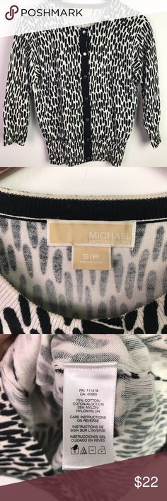 """Michael Kors Black White Cardigan Sweater Petite S Michael Kors women's black, white print cardigan sweater. Size small. This has 3/4 sleeves. C O N D I T I O N: Gently used. Clean. No issues.  M E A S U R E M E N T S: (Laying Flat)  17"""" armpit to armpit  19"""" sleeves (shoulder seam to cuff) 22"""" long (shoulder to bottom) M A T E R I A L: 75% cotton, 25% nylon KORS Michael Kors Sweaters Cardigans"""