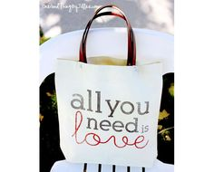 DIY Canvas Tote Revamp - get the stencil at http://www.733blog.com/2012/07/all-you-need-is-love-cedar-plank-sign.html