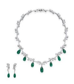 A SUITE OF EMERALD AND DIAMOND JEWELRY, BY TIFFANY & CO. Comprising a necklace, designed as a circular-cut diamond scrolled band, the front...