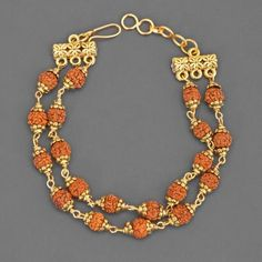 This Ethnic Rudraksha Mens Bracelet Online is more on the opulent side. With the beads running on two strings instead of just one, it gives a more lavish look to your outfit and yourself. But you'd have to try it to see its desired effect! Ed Stone, Trendy Collection, Rakhi, Bracelet Designs, Bracelets For Men, Ethnic, Gold Necklace, Chain, Beads