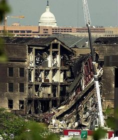 Firefighters and inspectors look over the damage to the Pentagon in Washington one day after a hijacked airliner crashed into the Department of Defense building on Sept. The dome of the United States Capitol is seen in the background. We Will Never Forget, Lest We Forget, Flatiron Building, 11 September 2001, Moslem, Historia Universal, Che Guevara, World Trade Center, Our World