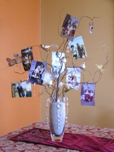 Photo tree centerpiece.  See more 80th birthday party suggestions at one-stop-party-ideas.com.