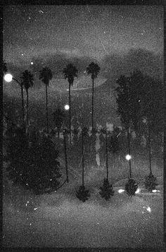 auxiliofaux:  night time eskimo kiss (long exposure)  Pentax K1000/Arista EDU 100/35mm  Los Angeles, California  ©2012Auxiliofaux  Society6