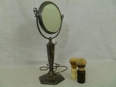 Antique Shaving Mirror, Pedestal Shaving Mirror by FairchildsInc on Etsy Decorative Hooks, Antique Pewter, After Shave, Pedestal, Candle Sconces, Shaving, Silver Plate, Wall Lights, Soap