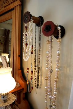 old spools used for hanging jewelry