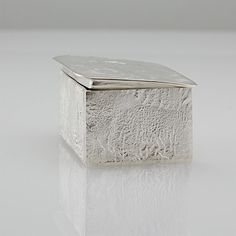 Handcrafted reticulated silver and sterling silver box. This box would make a lovely little pill, treasure or presentation box. The sides and the top of this box are made from reticulation silver, the bottom is composed of sterling silver. The top of the box forms a tight