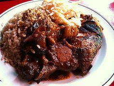 Jerk chicken served for Kwanzaa with oxtails, rice and cabbage.