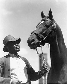 Man o' War with his groom, Will Harbut.