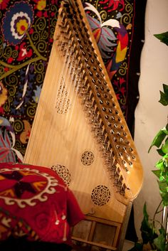The Qanun, or kanun is a beautiful harp found in Egypt and across the Middle East. Traditionally, it has 26 strings.