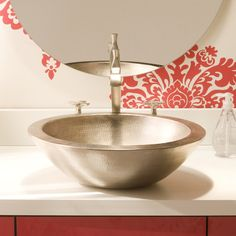 In a brushed nickel finish, the Laguna is a flawless work of art. Laguna's perfectly formed brushed nickel halved copper sphere vessel could be the only decor you need in your bathroom. Wall Mounted Bathroom Sinks, Copper Bathroom, Undermount Bathroom Sink, Faucet, Copper Vessel Sinks, Hammered Copper, Antique Copper, Kitchen And Bath, A Boutique