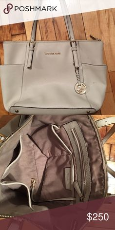Michael Kors Purse Still cute for any season, needs a light clean job but it's still pretty great! I wear mostly black bags so looking to get rid of this one! Michael Kors Bags Shoulder Bags