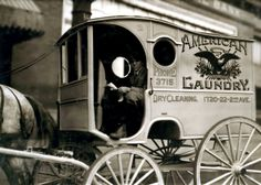 """This photograph shows a young boy at the reins of a laundry delivery wagon in Birmingham, Alabama, 1914.   The photograph is one in a series of child labor photographs taken by Lewis Hine.Here is the full archival entry for the photograph: """"One of the young wagon boys. There are a good many of these at certain seasons of the year. Location: Birmingham, Alabama. October, 1914."""""""