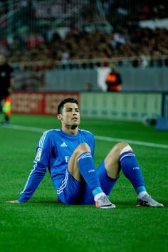 Cristiano Ronaldo lies on the ground after being tackled during the La Liga match between Sevilla FC and Real Madrid CF at Estadio Ramón Sánchez Pizjuán on March 26, 2014 in Seville, Spain.